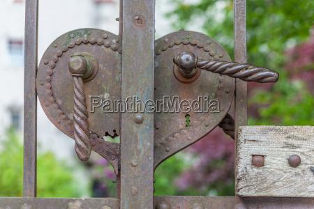 old rusty door pusher