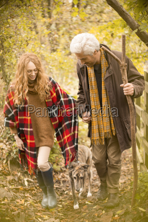 couple with dog and walking stick