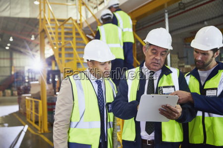 manager and workers with clipboard meeting