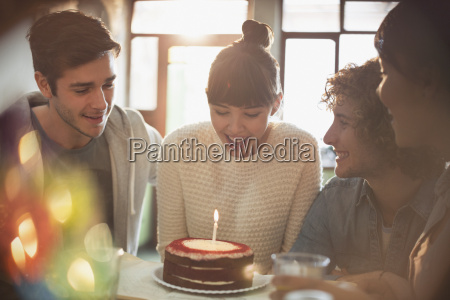 young adult friends celebrating birthday with