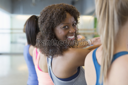 portrait smiling woman enjoying exercise class