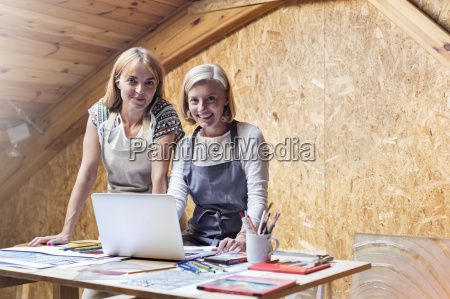 portrait smiling artists with laptop and