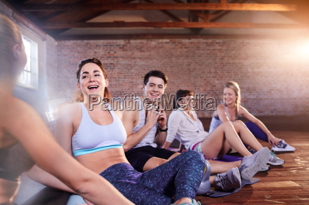 smiling young dancer friends relaxing hanging