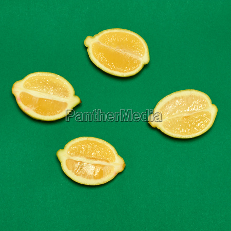 lemons on green background