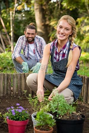 portrait of happy gardener with colleague