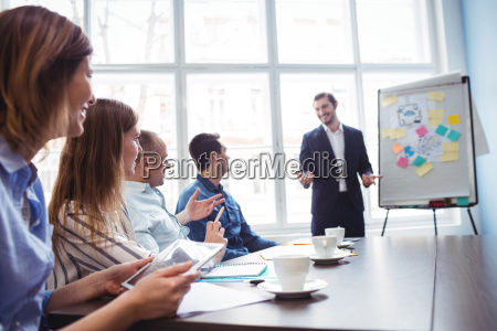 businessman giving presentation in front of