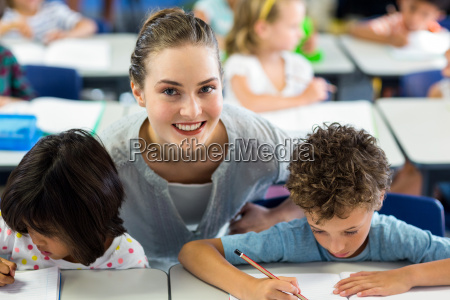 portrait of happy female teacher helping