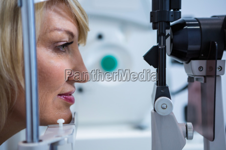 female patient under going eye test
