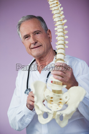 portrait of physiotherapist examining a spine
