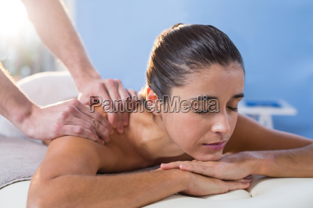 physiotherapist giving shoulder therapy to a