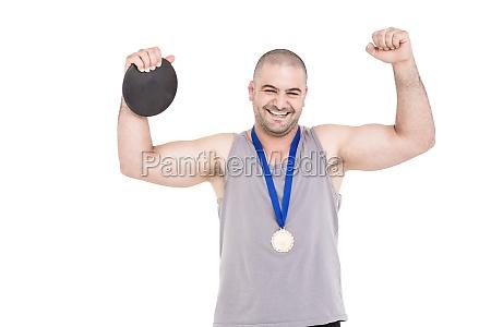 portrait of athlete winning gold medal