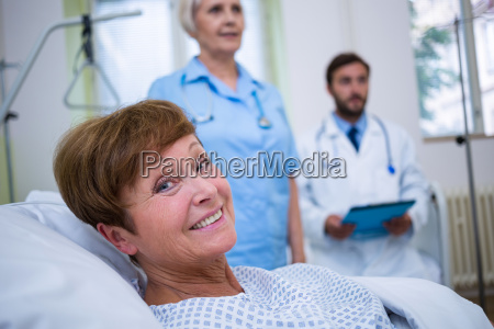 portrait of smiling patient lying on