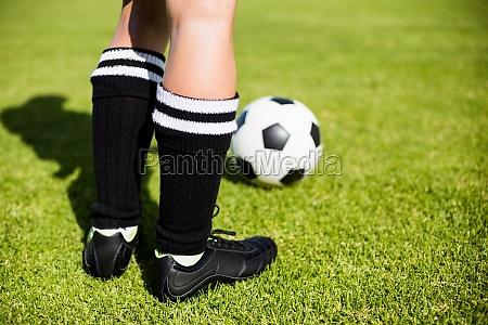 feet of a female football player
