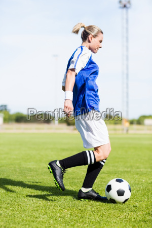 female football player practicing soccer