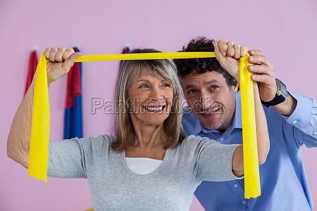 senior woman training with exercise band