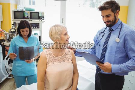 male doctor interacting with a patient