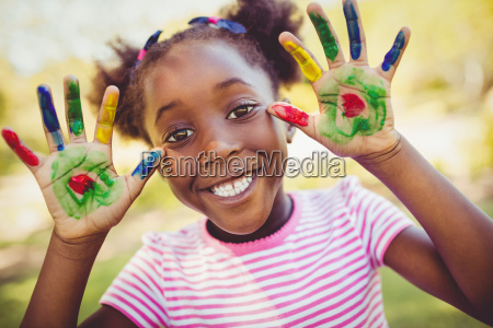 little girl showing her painted hands