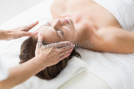 cropped hands of therapist performing reiki
