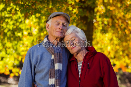 senior couple with eyes closed at