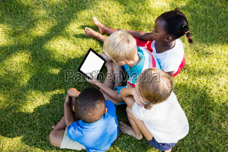 kids using technology during a sunny
