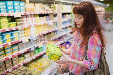 serious woman choosing butter