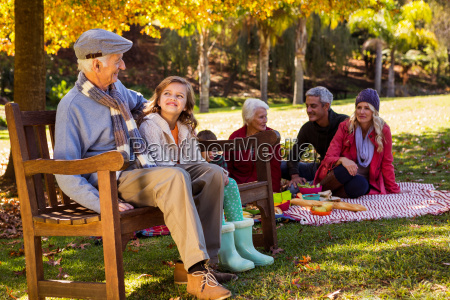 family picnicking and the grandfather laughing