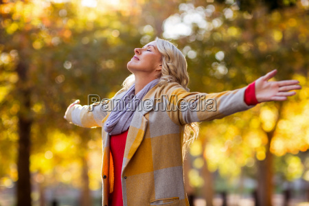 woman standing with arms outstretched against