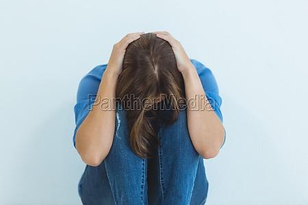 sad woman sitting at home