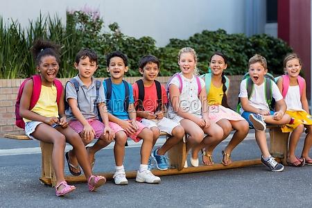 smiling schoolchildren on seat