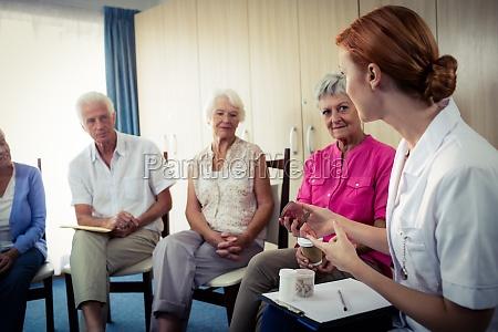 seniors interacting with nurse