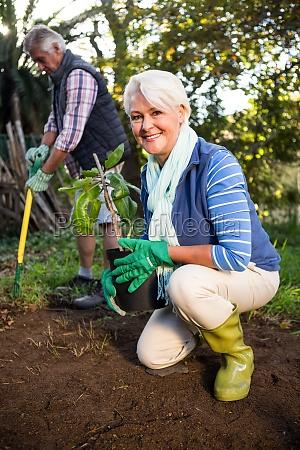 portrait of happy female gardener with