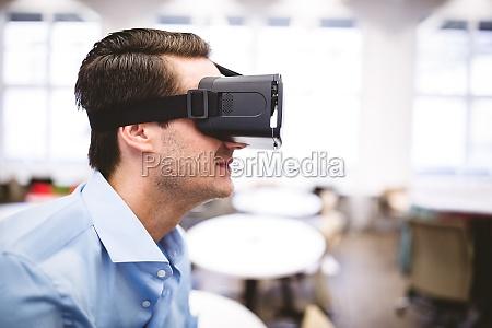 side view of executive enjoying virtual