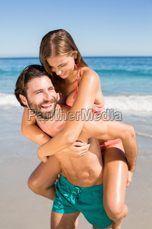 man giving piggy back ride to