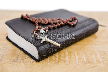 close up of bible and rosary