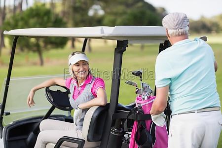 smiling golfer couple