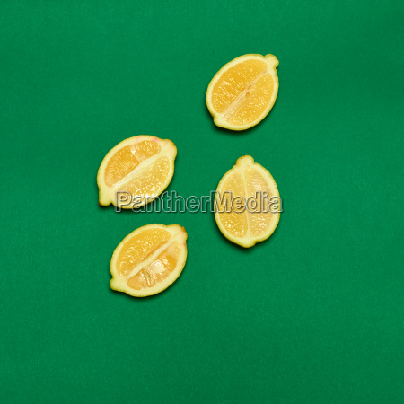 lemons on green background