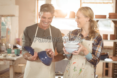 smiling potters checking pots