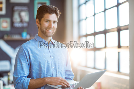 male business executive using laptop