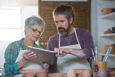 potters using digital tablet