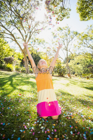 girl standing with arms outstretched in
