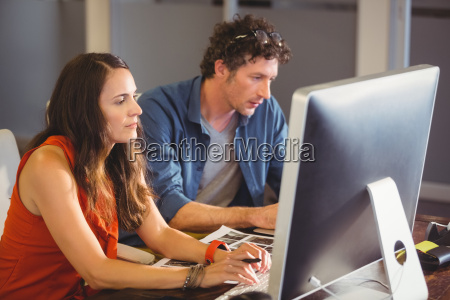 casual colleagues using computer