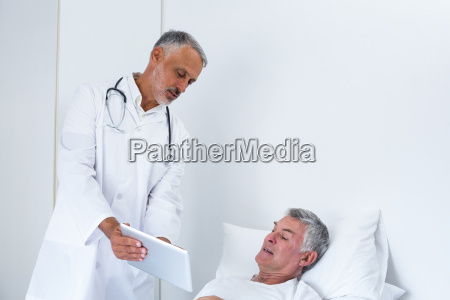 male doctor discussing medical reports with
