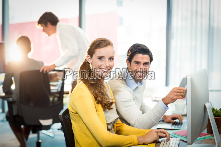 portrait of executives working on laptop