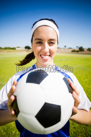 happy soccer player standing with a