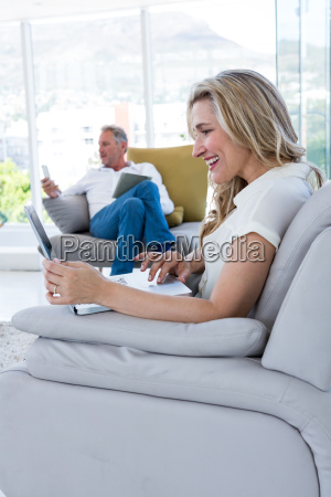happy woman with laptop and man