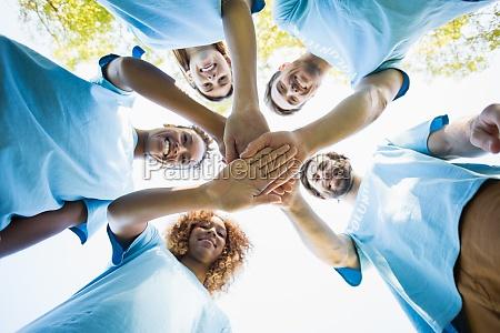 group of volunteer forming huddles