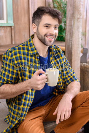 side view of smiling man sitting