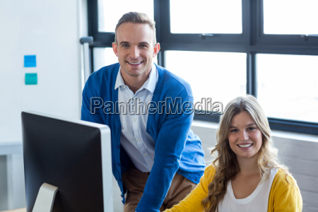 portrait of smiling colleagues in office