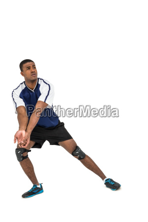 sportsman posing while playing volleyball