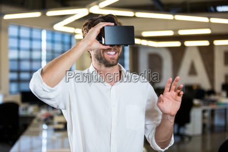businessman wearing virtual reality simulator